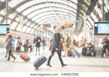 Blurred Woman With Suitcase And Crowd Of People At The Train Station.