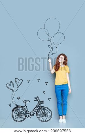 Simple Happiness. Cheerful Happy Young Woman Smiling And Holding Balloons While Thinking About Her L