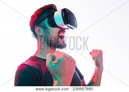 Cheerful Expressive Man With Beard Wearing Glasses Of Virtual Reality And Holding Fists Up In Win Wa