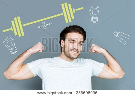 Feeling Strength. Cheerful Emotional Strong Student Feeling Satisfied With His Good Shape After Doin
