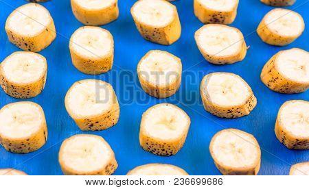 Banana Pattern Sliced Banana Slices On Blue Horizontal