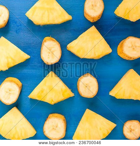 Banana , Pineapple Pattern Sliced Banana Slices On Blue, Top View