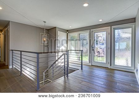 Spacious Entrance Hallway With Gray Walls