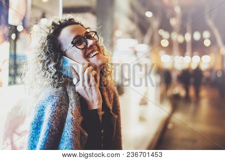 Smiling Pretty Woman Making Conversation Call With Her Friends Via Cell Telephone While Standing At