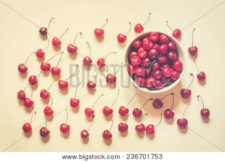 Cherries In Bowl And Near On Beige Background