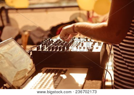 Dj Behind The Remote Control Works To Adjust The Sound