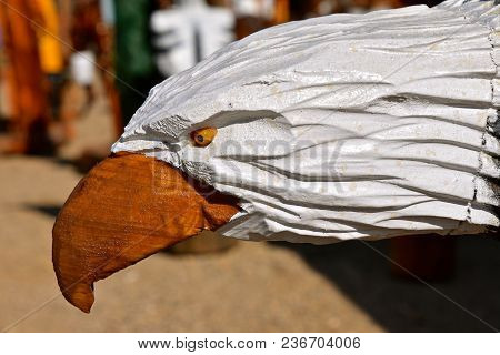 Closeup Of A Wood Chainsaw Carving Of The Black And Head Of A Bald Eagle.
