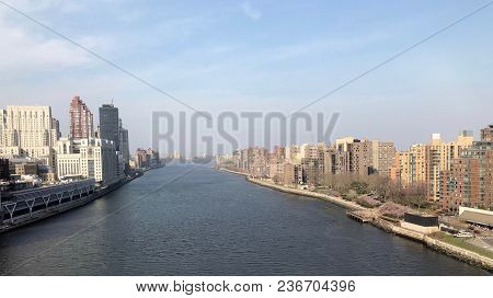 The Water In The East River Flowing Between Roosevelt Island And Manhattan
