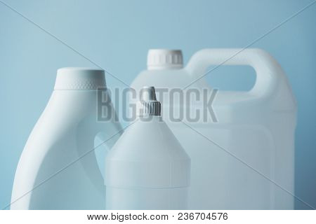 White Plastic Jerrycan And Bottle Canister For Chemical Liquids, Blank Unlabelled Surface As Copy Sp
