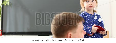 Dad Play With Cute Little Girl In Blue Dress On Floor Carpet At Home Portrait