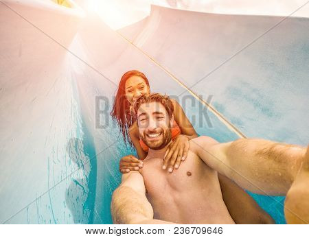 Happy Crazy Couple Taking Selfie Photo With Action Camera In Aqua Park - Young People Having Fun In