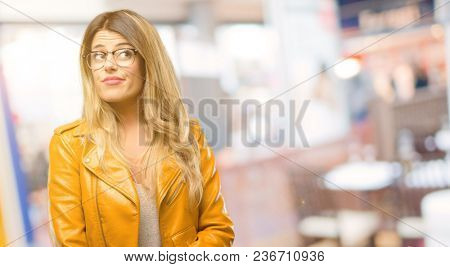 Beautiful young woman doubt expression, confuse and wonder concept, uncertain future at restaurant