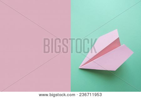 Flat Lay Of Pink Paper Plane On Pastel Pink And Turquoise Background With Text Space.
