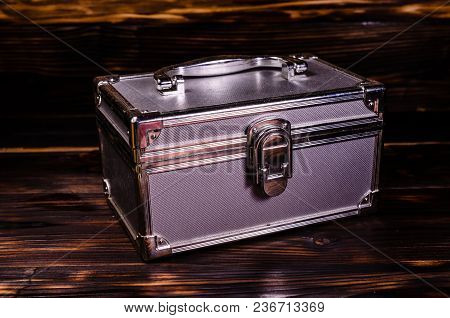 Aluminium Make-up Case Or Jewellery Accessories Box On Wooden Background