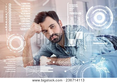Thoughtful Man. Calm Clever Freelance Translator Thoughtfully Looking Into The Distance While Being