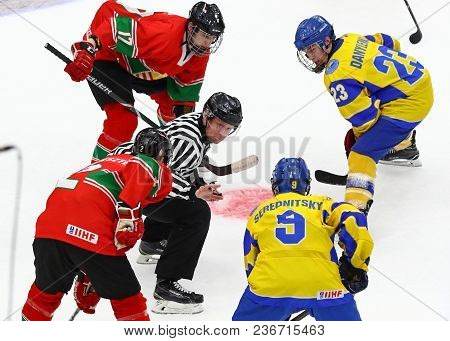 Kyiv, Ukraine - April 17, 2018: Referee Face-off The Rink During The Iihf 2018 Ice Hockey U18 World