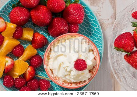 Strawberries With A  Whipped Cream On Wooden Table