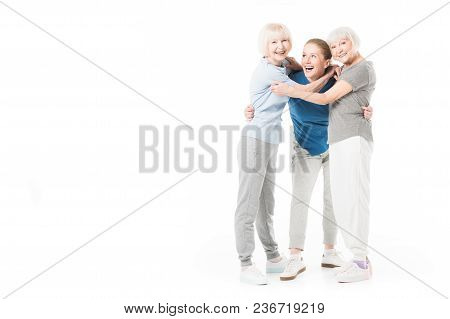 View Of Three Sportswomen Embracing Isolated On White