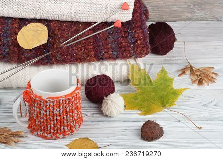 Knitted Wool Sweaters. Pile Of Knitted Winter, Autumn Clothes On Wooden Background, Sweaters, Knitwe