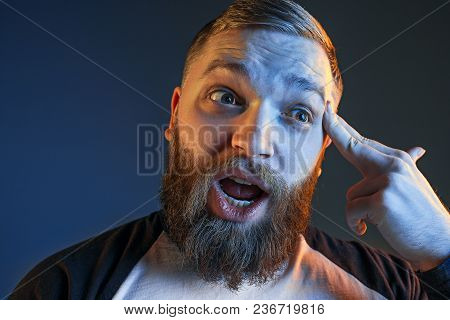 The Anger And Screaming Man. Hate, Rage. Crying Emotional Angry Man In Colorful Bright Lights At Stu