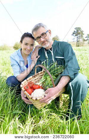 Portrait of happy couple of farmers