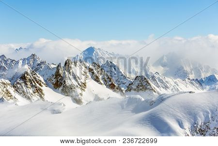Wintertime View From Mt. Titlis In Switzerland. The Titlis Is A Mountain, Located On The Border Betw