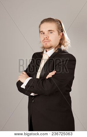 Portrait Of Handsome Young Man In A Tuxedo. Fashionable Clothing For The Festive Evening.