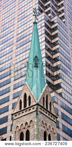 Steeple Of A Traditional Catholic Church Is Surrounded By Taller Office Buildings, Concept