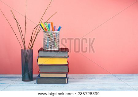 Book Stacking. Open Book, Hardback Books On Wooden Table And Pink Background. Back To School. Copy S