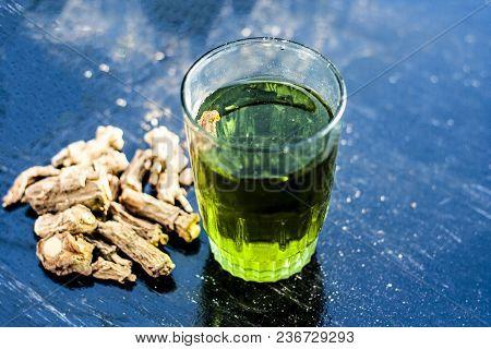 Herbal And Beneficial Extract Or Syrup Of Indian Sarsaparilla Or Naruneendi Or Nannari In A Transpar