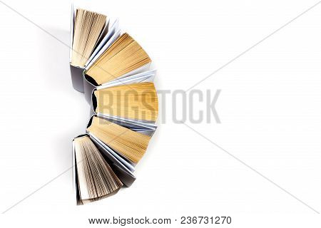 Top View Of Colorful Hardback Books In A Circle. Open Book, Fanned Pages. Back To School Copy Space.