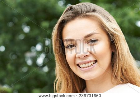 Head And Shoulders Portrait Of Smiling Teenage Girl