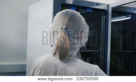 Medical Virology Research Scientist Works With Mask. Clip. Scientist Takes Out Test Tubes From Refri