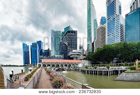 Singapore, Singapore - January 16, 2018: Singapore Skyline And View Of Marina Bay Seen From The Pier