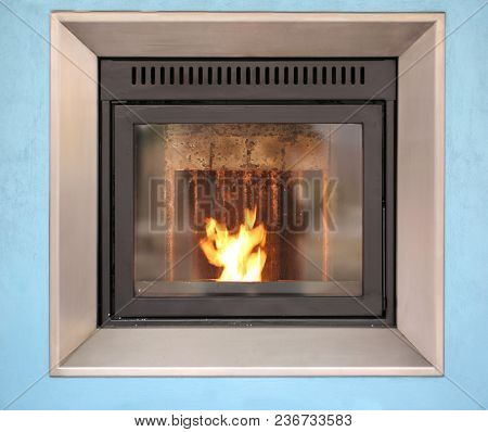 Modern Stove With A Warm Flame And Protective Glass