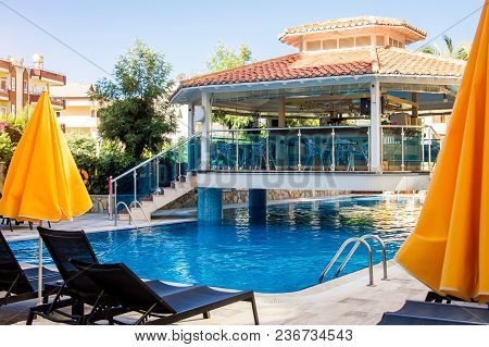 Alanya, Turkey, September 8. Empty Hotel Bar Situated Over Swimming Pool. Villa Sunflower In The Mor
