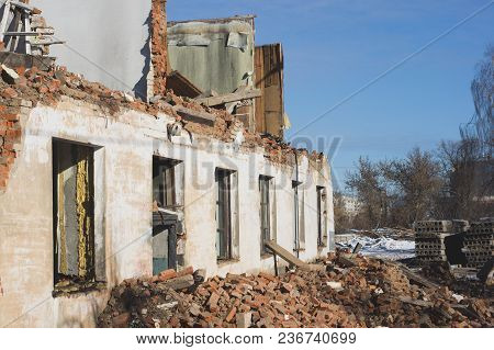 View Of A Dilapidated House. The Destroyed Walls In The Process