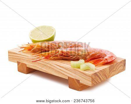 Argentine Red Shrimp On A Wooden Bred. Shrimp And Lemon Flatlay