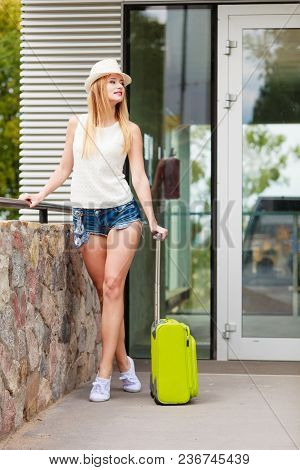 Travel, Adventure, Teenage Journey Concept. Attracitve Woman Wearing Denim Shorts, White Top And Sne