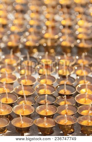 Bronze Prepared Oil Lamps For Fire Donations Before Using In A Buddhist Temple. Background Image.
