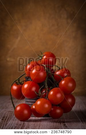 Juicy Fresh Red Tomatoes On Wooden Board In Vintage Can