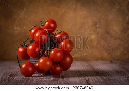 Juicy Fresh Red Tomatoes On Wooden Board In Vintage Tin