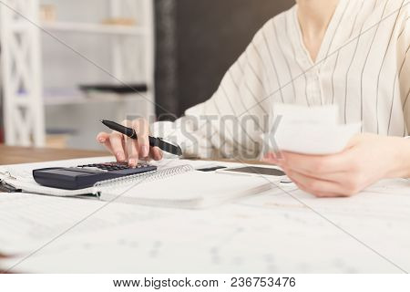 Closeup Of Woman Hands Counting Account On Calculator And Holding Checks. Financial Background, Coun