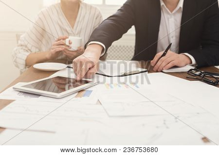 Closeup Of Business Colleagues Hands Pointing On Digital Tablet With Blank Screen For Advertisement.