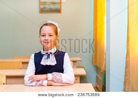 Little First-grader, Girl-student In School On Knowledge Day - 1. September. Student Of Elementary S