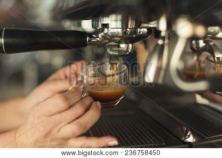 Experienced Barman Making Espresso In Modern Coffee Machine. Closeup Of Female Hand Preparing Bracin