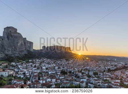 Sunrise View Of Meteora Rock Formation And City Of Kalabaka In Central Greece
