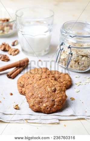 Homemade Oatmeal Cookies With Walnut And Cinnamon On Bright Background