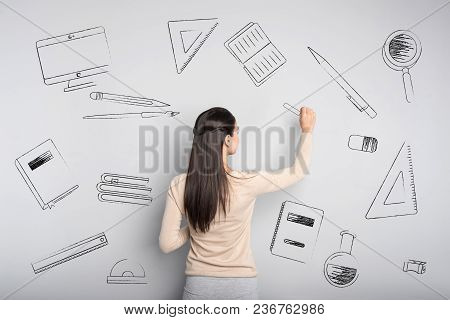Clever Teacher. Professional Experienced Teacher Of Mathematics Standing In Front Of The Blackboard