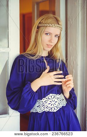 Pretty Blond Woman With Braided Hair, Dressed In A Blue Dress, Beautiful Portrait In The House, Simp